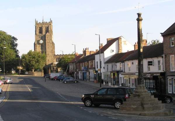 View of St Gregory' church and the Market Cross from the Market Place